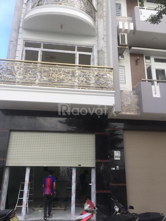 Nhà 4 lầu mặt tiền đường 7m, diện tích 4mx15m, Tân Phú (ảnh 1)