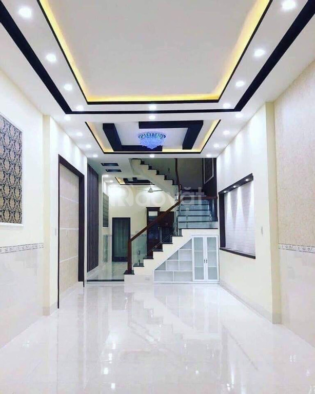 Nhà 3 lầu mặt hẻm xe hơi 1135 Huỳnh Tấn Phát Quận 7