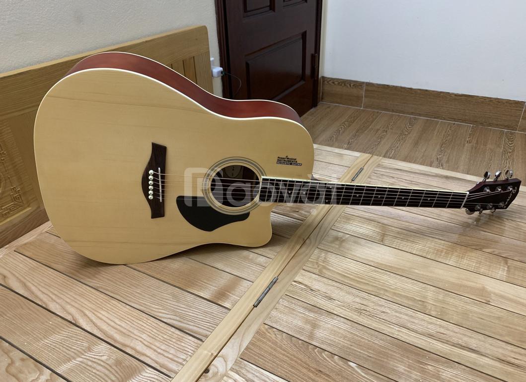 Chị mình nhờ bán hộ cây đàn guitar mới nguyên 1tr550