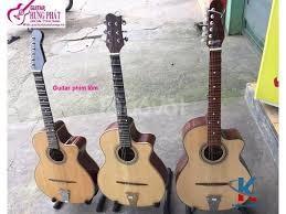 Bán guitar cổ thùng phím lõm giá rẻ tại Bình Dương