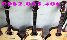 Tiệm cung cấp đàn guitar thùng vọng cổ gỗ Son Đào lâu năm giá hợp lí