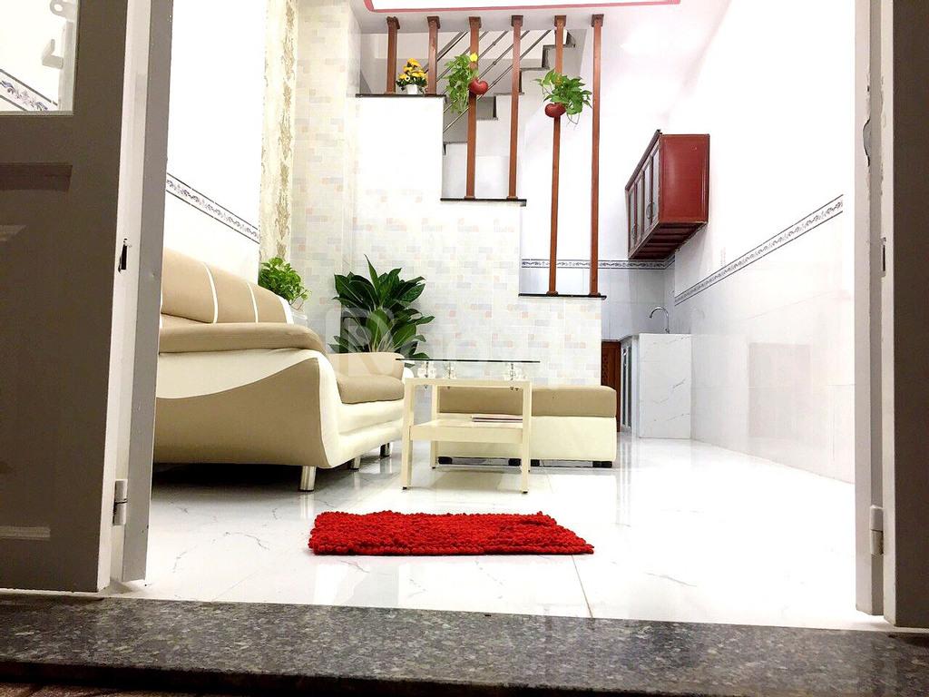 Nhà 1 trệt, 2 lầu, sổ hồng riêng, đường Huỳnh Tấn Phát