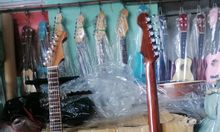 Đàn guitar tân cổ phím lõm tại quận Tân Phú