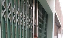 Làm cửa kéo sắt hoặc sửa cửa sắt kéo