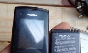Điện thoại Nokia X1 đồng bộ cả máy và xạc